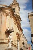 Statue of Virgin Mary with Jesus child on the corner of Carmelite Priory in Mdina. Malta.  Stock Photos