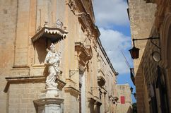 Statue of Virgin Mary with Jesus child on the corner of Carmelite Priory in Mdina. Malta.  Royalty Free Stock Photo