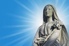 Statue of Virgin Mary in the rays of the sun Stock Images