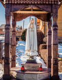 The statue of the virgin Mary in a small village in the Carpathian mountains royalty free stock photo