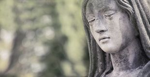 Statue of Virgin Mary in tears sadness, regret, fear, faith, re. Ligion, depression Royalty Free Stock Image