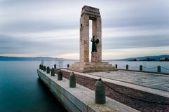 Statue of Vittorio Emanuele. Statue of Vittorio Emanuele III on a stone pier suspended over the sea, in Reggio Calabria, photograph by using Neutral Density Stock Photography