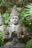 Statue von Buddha meditierend Stockbild