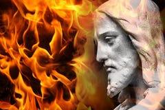 Statue von Jesus/von Gott mit Feuer Stockfoto