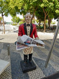 Statue waiter - advertising banner. Restaurants in the city of Faro. Southern Portugal. October 4, 2016 Royalty Free Stock Photography