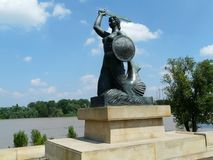 Statue of the Warsaw mermaid by the Vistula river,Warsaw,Poland royalty free stock photos
