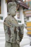 Statue at Wat Suthat in Bangkok Stock Photo