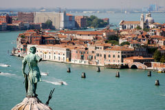 Statue watching a glimpse of Venice Stock Photo