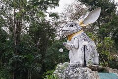 The statue of the white rabbit in the garden of the Wat Samphran, Thailand stock images