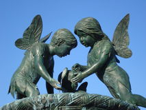 Statue of winged little girl and boy Royalty Free Stock Photography