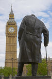 Statue of Winston Churchill. In Parliament Square in London, England with the Elizabeth Tower of the Houses of Parliament in the background Stock Photography