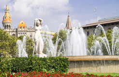 Statue of a woman in the city center. With fountains Stock Photos
