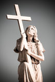 Statue of woman with cross Stock Image