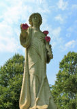Statue of a Woman with flowers Royalty Free Stock Photography