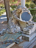 Statue of a woman with mirror Royalty Free Stock Photography