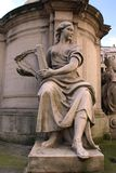 Statue of a woman musician playing a harp Royalty Free Stock Image