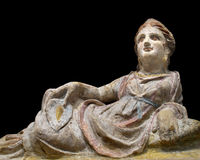 Statue of woman reclining isolated. Royalty Free Stock Images