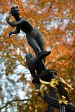 Statue of a woman running with a dog as decoration in London park royalty free stock photos