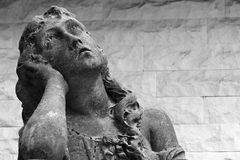 Statue of a woman with a sorrow expression Stock Photo