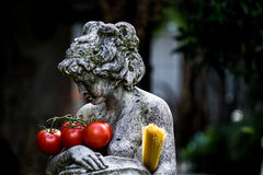 Statue of woman with tomato and spaghetti Stock Photography