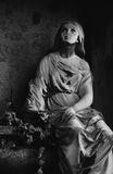 Statue of woman on tomb as a symbol of depression Stock Photography