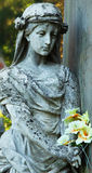 Statue of woman on tomb as a symbol of depression and sorrow (Ly Stock Photos