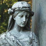 Statue of woman on tomb as a symbol of depression and sorrow Stock Photos