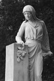 Statue of woman on tomb as a symbol of depression and sorrow Royalty Free Stock Image