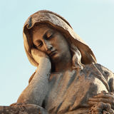 Statue of woman on tomb as a symbol of depression and sorrow Stock Photo