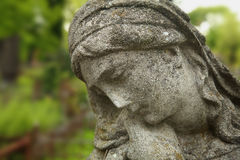 Statue of woman on tomb as a symbol of depression and sorrow Stock Photography