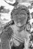 Statue of woman on tomb as a symbol of depression and sorrow Royalty Free Stock Images