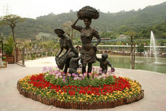A statue of women and children at OCT East Theme park Stock Images