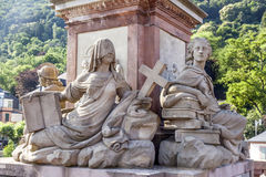 Statue of women with cross Royalty Free Stock Photography