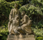 Statue of the workers' revolutionary movement. Taken May 22, 2016 Jablonec nad Nisou Czech Republic sculpture of three figures, two men and a young and older Royalty Free Stock Images