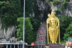 Statue. World's tallest Murugan statue stood right next to steps heading up into the temple in the cave Royalty Free Stock Images