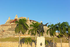 Statue of wounded General Blas in front of San Felipe de Barajas fortress at sunset. Royalty Free Stock Photography