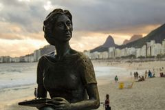 Statue of the writer Clarice Lispector with her dog `Ulisses` in the `Fishermen`s Way` with the sea in the background on the beach stock photos