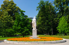 Statue of the writer Janko Kral. Statue of the famous writer Janko Kral in a park with UFO bridge behind in Bratislava, Slovakia Royalty Free Stock Images