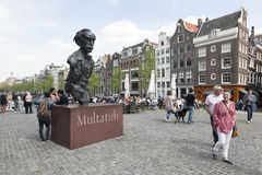 Statue of writer multatuli on bridge over Singel in Amsterdam Royalty Free Stock Photos