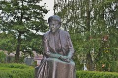 Statue of the writer Selma Lagerlof, Karlstad, Sweden. Karlstad, Sweden - July 29, 2015: Bronze Statue of the famous writer Selma Lagerlof, who was born not far Royalty Free Stock Images