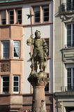 Statue of Yeoman atop a fountain. Place de la Réunion, Mulhouse. The epicentre of the life of Mulhouse is Place de la Réunion. The square takes its name from Royalty Free Stock Photos