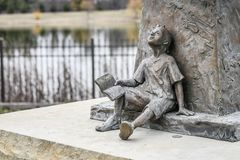 Statue of a Boy with Book - Dreaming royalty free stock images