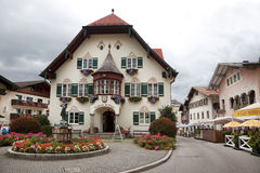 Statue of young Mozart and townhall on Mozartplatz in St. Gilgen. Austria Stock Images