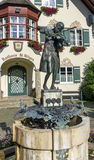 Statue of young Wolfgang Amadeus Mozart in St. Gilgen, Austria. Statue of young Wolfgang Amadeus Mozart in front of townhall on Mozartplatz in St. Gilgen Stock Photography
