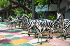 The statue of zebras. On colourful floor Stock Images