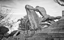 Zeus statues. Statue of Zeus fighting and trying to crush an opponent with a rock Royalty Free Stock Photos