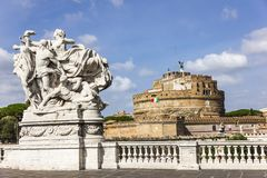 """Statue""""Loyalty to the Statute. Ponte Vittorio Emanuele II and Castel Sant`Angelo in Rome royalty free stock photo"""