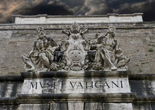 Statues aboe the exit from the Vatican Museums royalty free stock images
