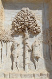 Statues of Adam and Eve with Apple tree in the facade of Abbey C Stock Image