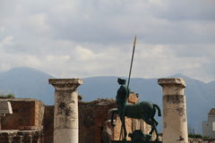 Statues at the Ancient Pompeii Italy. With columns and mountains in the background Stock Image